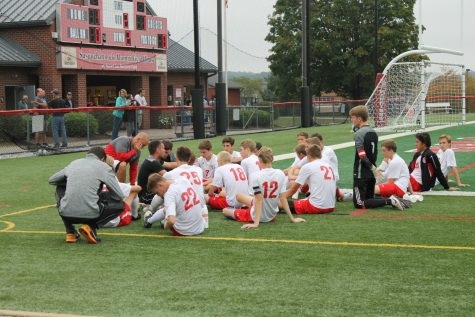 The varsity team in a huddle during halftime.