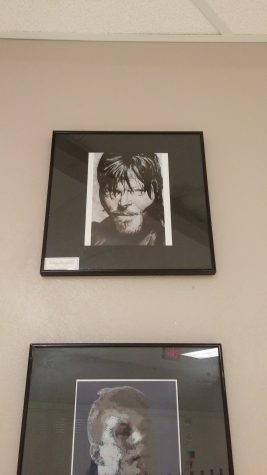 Art of Daryl Dixon hangs outside of the library (Artwork by David Gallegos). Photo by: Ariel Barbera