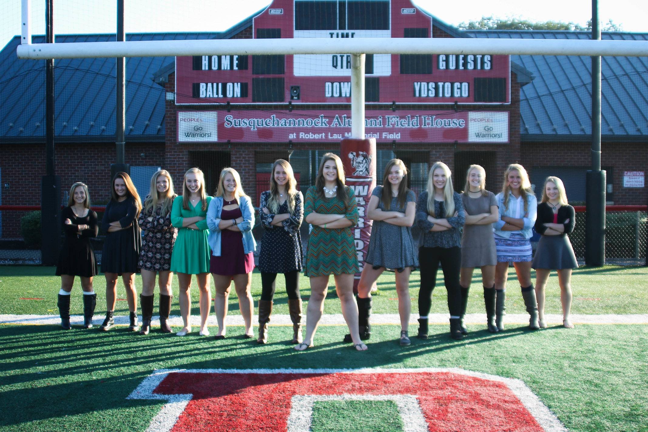 The 2016 Homecoming court poses on the feild. Photo by: Wade Bowers.