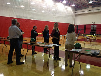 Before freshmen showed up, adults were trained on what they were supposed to do at their station. Pictured above, adults were told the plan for an obstacle course.