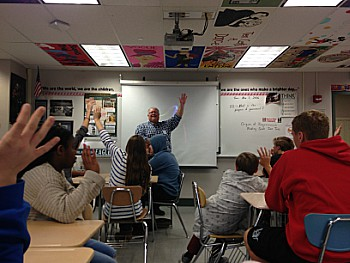 Teens interacted with employees from Adhesives Research Inc. to talk about how common tape is. Shown above, students raised their hands to prove how they had used tape throughout the day.