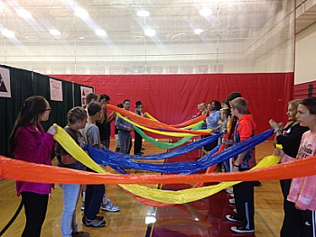 This station gave students the opportunity to take part in multiple hands-on activities. In  particular, a favorite was using a  balloon-like tube with a partner to see how many breaths it took to blow it up.