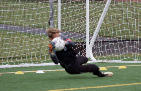 Goalie Aaron Biblie dives for a save. Photo by Dan McNair.
