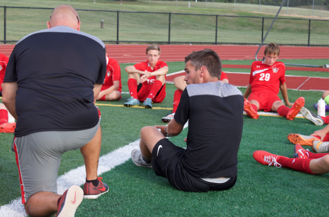 Coaches Brett Maxwell and Scott Kaifer speak to the team at halftime. Photo by Dan McNair.