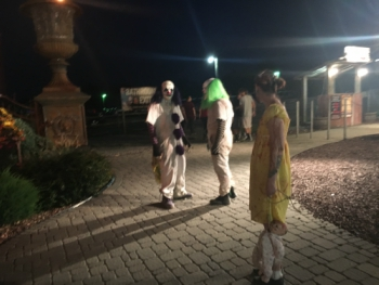 Three of the actors from Field of Screams roaming around the entertainment area.