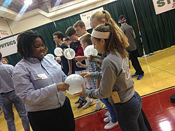 At the physics station, students were given the task of poking a hole through a balloon without popping it.