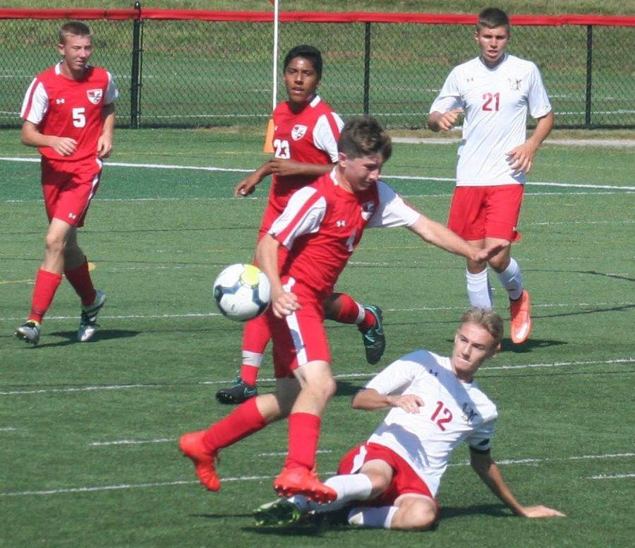 #12 Colton Mumley steals the ball. Photo Courtesy from Colton Mumley