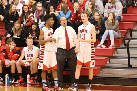 Junior Jordan McMillion and Senior Adam Hedgeland talk with Coach John Zerfing. Photo courtesy of Adam Hedgeland.