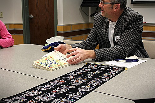 Scott Katz from the Jewish Communtiy Center shows students different things that are important in his religion.