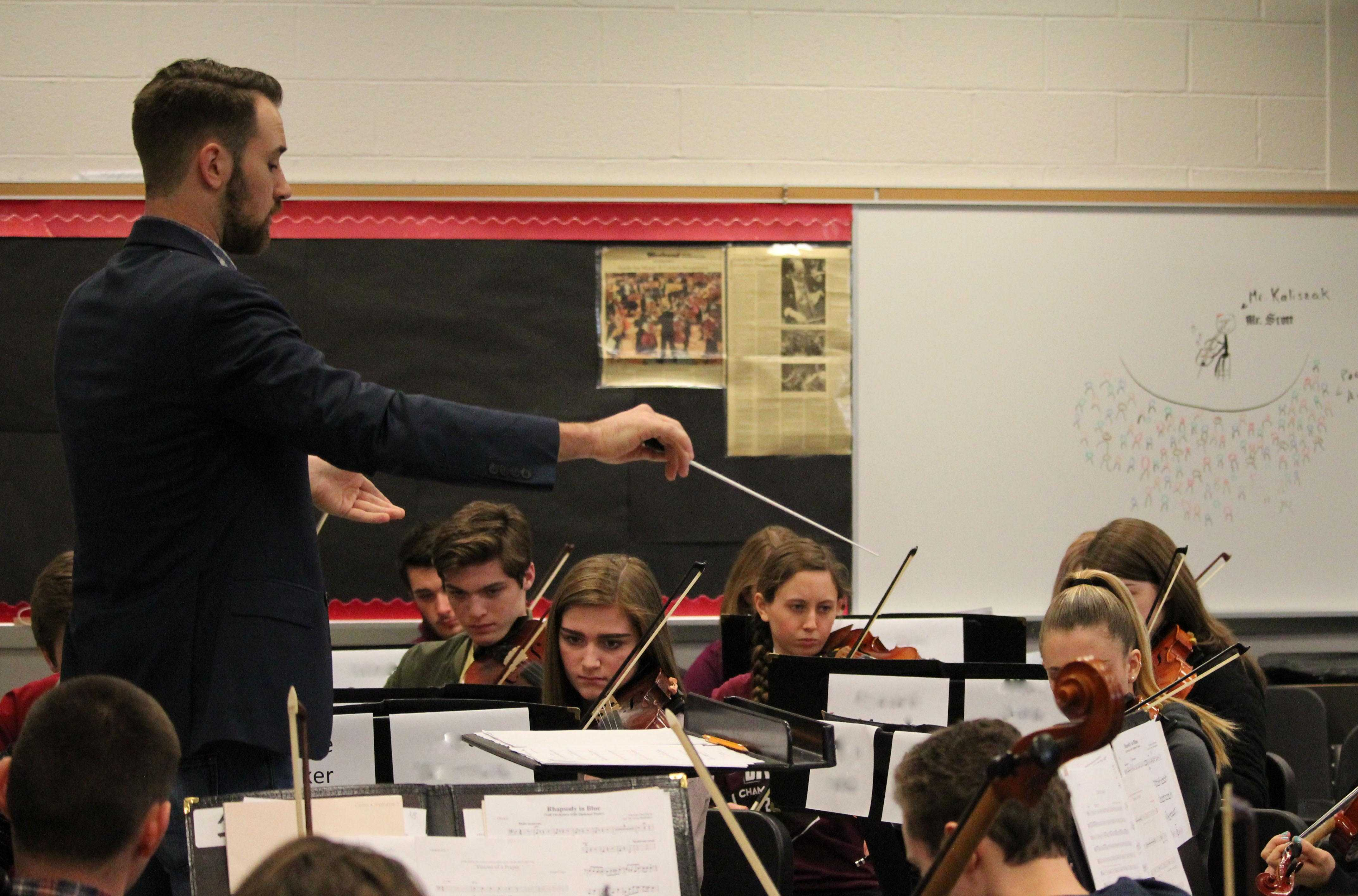 Susquehannock High School orchestra students rehearse for their chamber music concert under the direction of guest conductor Derek Cooper from the Manhattan School of Music.