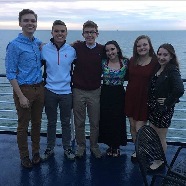 Juniors+Kaleb+Fair%2C+Brendan+Paules%2C+and+Justin+Feild%2C+sophomore+Theresa+Falzone+and+freshman+Natalie+Thomas+and+Bailey+Ryon+enjoyed+dressing+up+and+eating+dinner+with+their+friends+on+the+dinner+cruise.