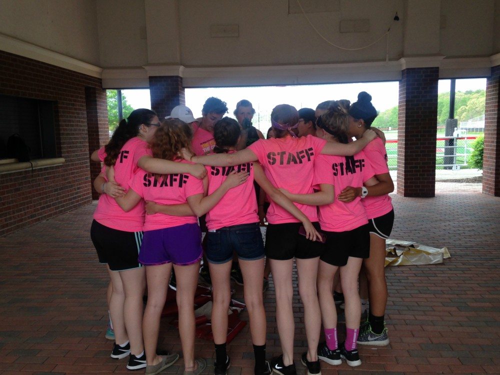 Student council members who staffed the Color Run stood in a huddle for a pep talk before the race began.
