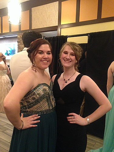 (From the left): Seniors Kristy Smith and Beth Ayers spend time taking pictures in the lobby. Photo by the author.