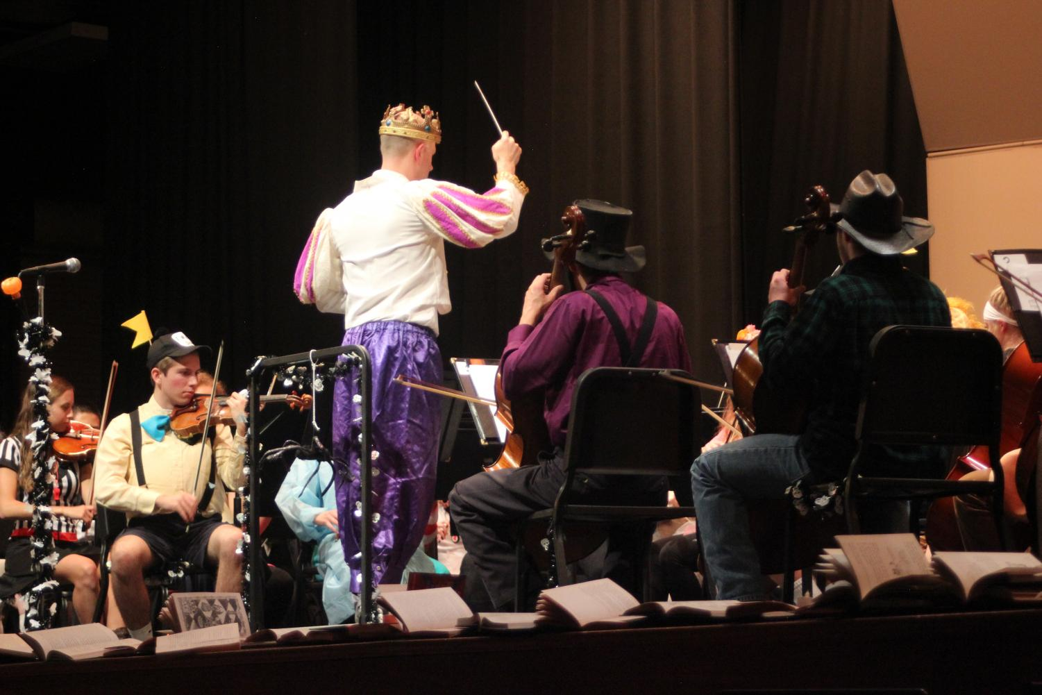 Zachary Levi conducts the high school orchestra. Photo by: Brittany Boone