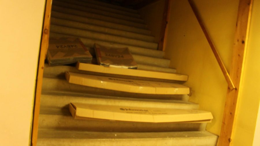 The stairs have materials scattered on top of them.