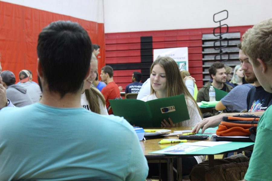 """Seniors work on the Budget Builder activity.  Senior Angel Gilbert thought that the budget builder was worthwhile. """"It was a helpful experience to help me prepare for the future,"""