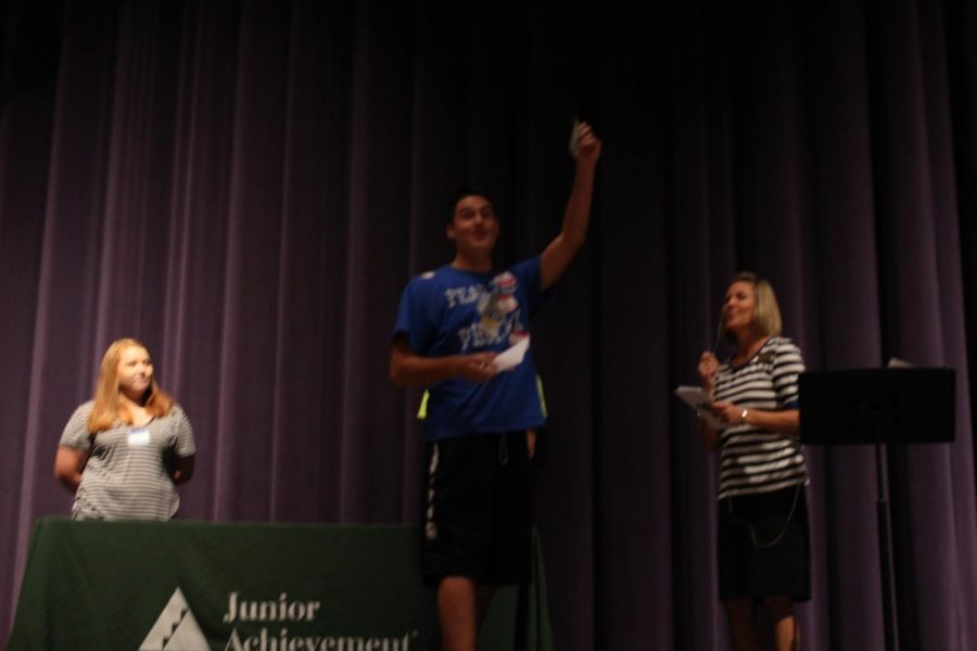 Senior Jacob Mahan wins a single dollar during the closing ceremony.
