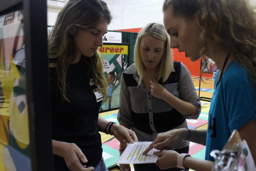 Senior Dakota Coleman gets help from Real Life volunteers.