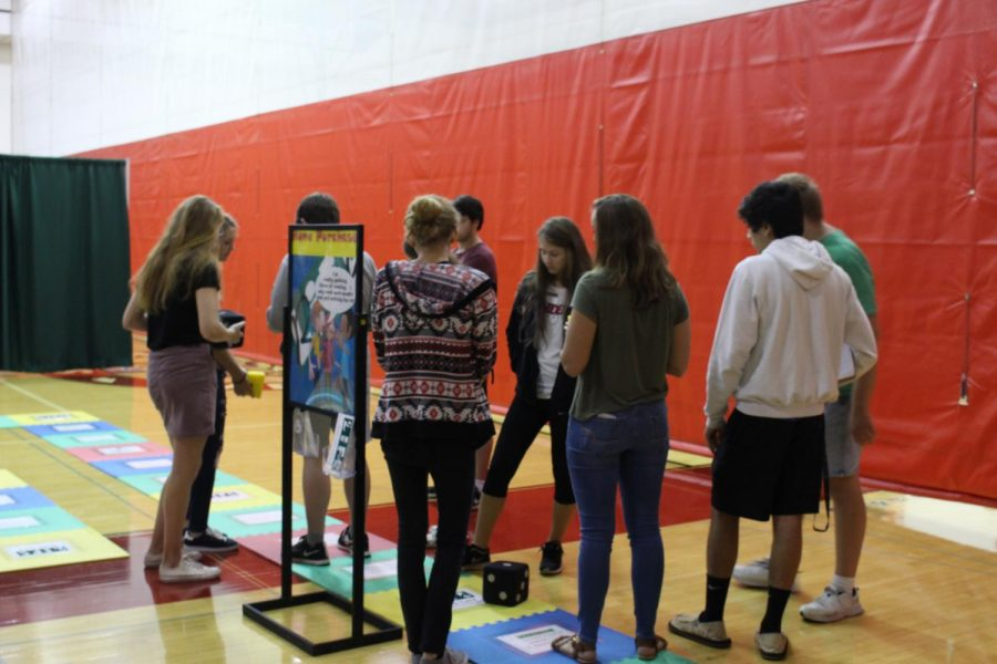 Seniors moved  around the life-size game board.