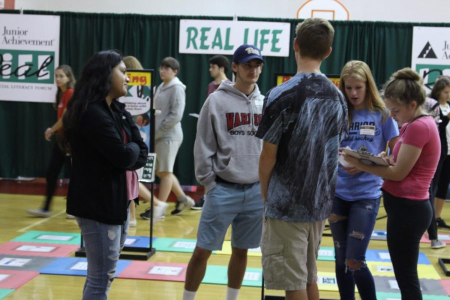 Seniors talk about what choice to make during one of the many Real Life games.