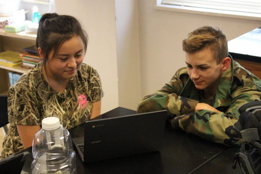 [From left to right] Juniors Brittany Dao and Matthew Keuler working on a CSI assignment