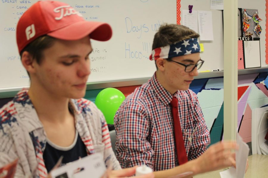 Seniors Kaleb Fair and Michael Torbert work on a student council project while sporting patriotic apparel for Wednesday, Oct. 18s spirit day. Photo by Christopher Norris