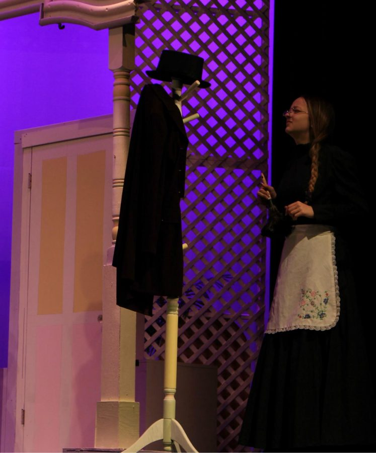 Junior Ella Wetzel (Gertrude) makes an announcement to the other characters on stage.