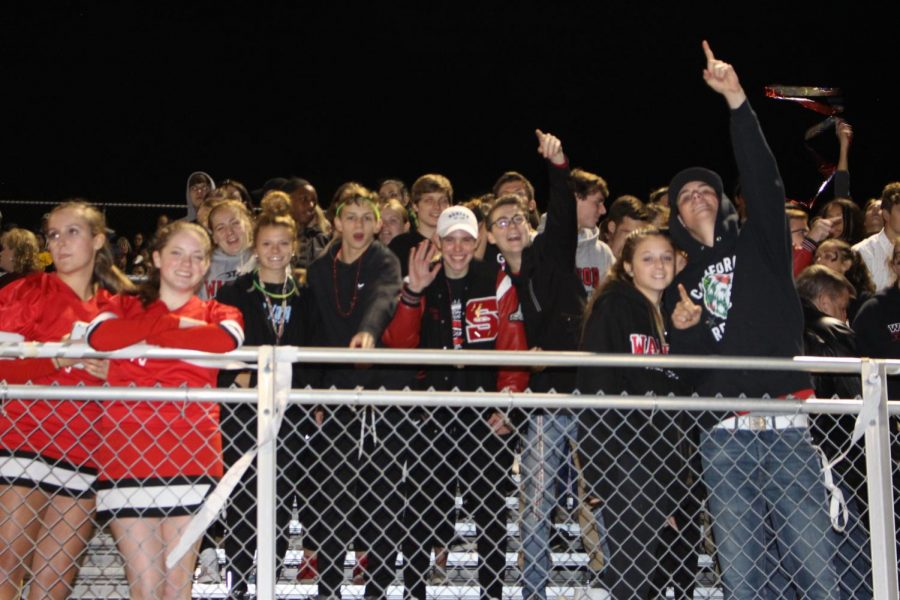 The Susky Student Section cheer on the Warriors in the third quarter.