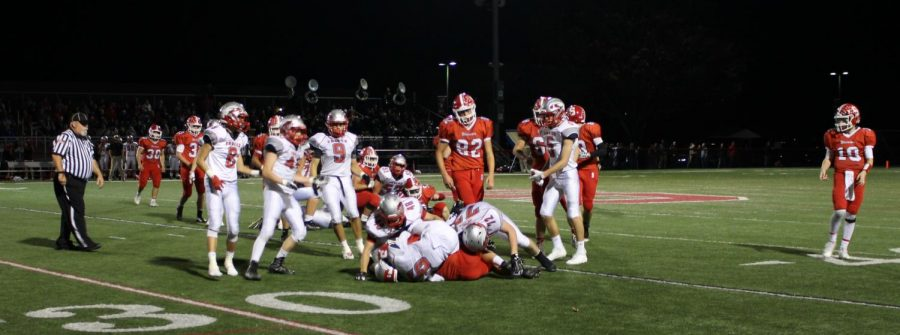 Dover makes the tackle on the Warriors offensive line.