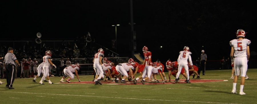 The Dover defense lines up against the Warrior offense.