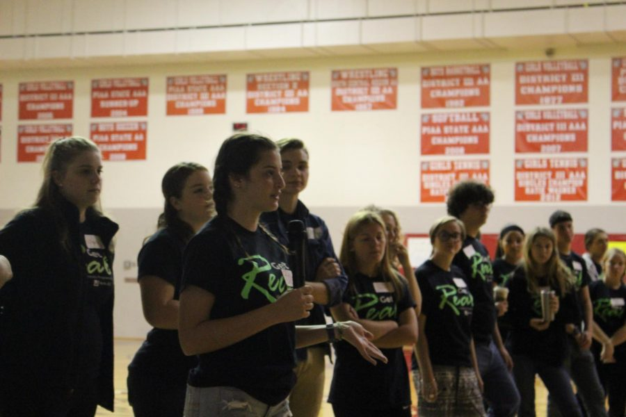 Senior leader Becca Martin speaks in front of the students before the day starts. Photo by Christopher Norris.