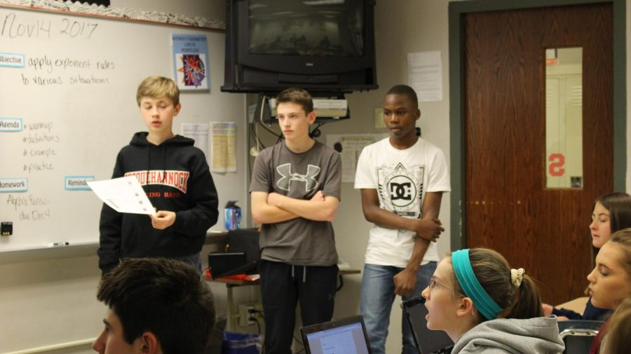 Freshmen+Cody+Choate%2C+Ben+Laubach%2C+and+Takib+Aroworowon+explain+the+process.+