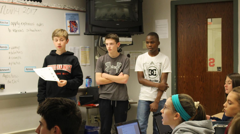 Freshmen Cody Choate, Ben Laubach, and Takib Aroworowon explain the process.