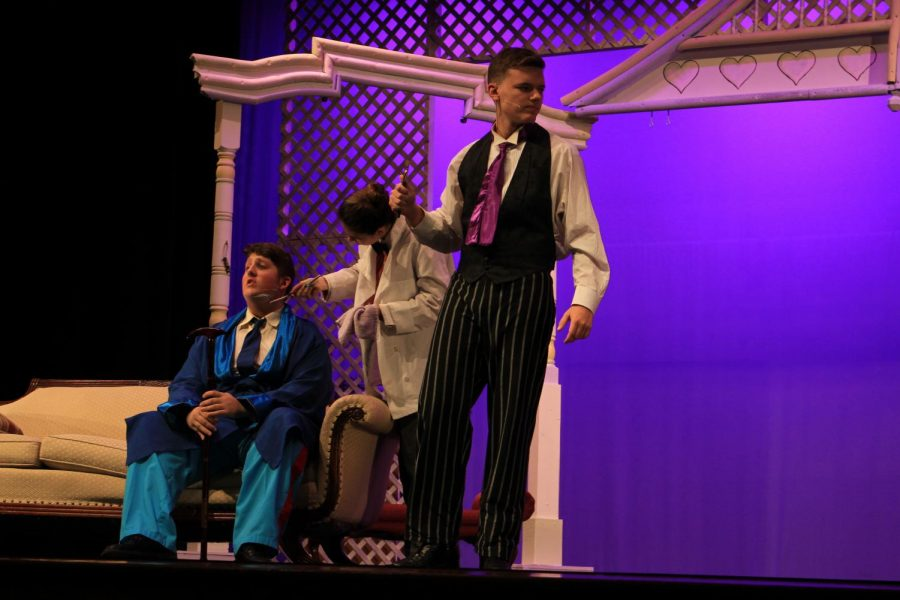 Senior Brendan Paules (Ambrose Kemper) gets frustrated with junior Dan Poole (Horace Vandergelder).
