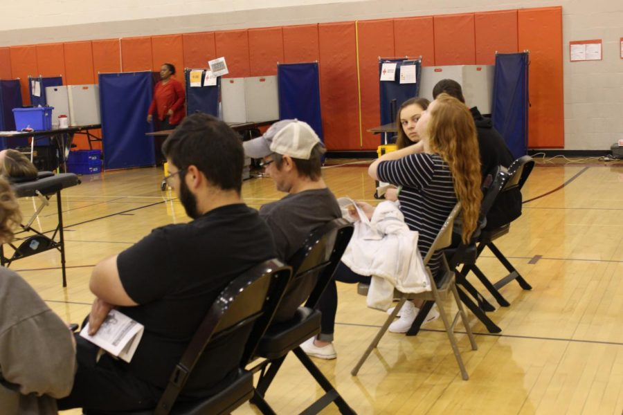 Students wait to get their blood drawn.