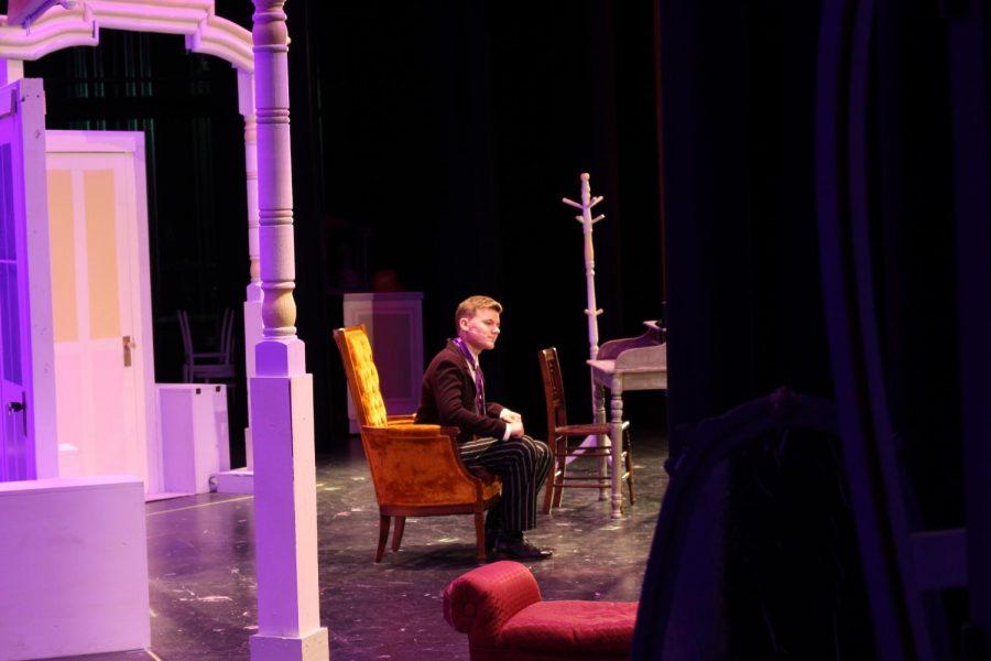 Senior Brendan Paules rehearses on the set.