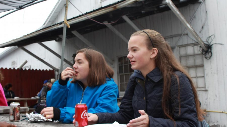 [Left to right] Juniors Kate Cramer and Julia Kelbaugh talk and enjoy lunch.