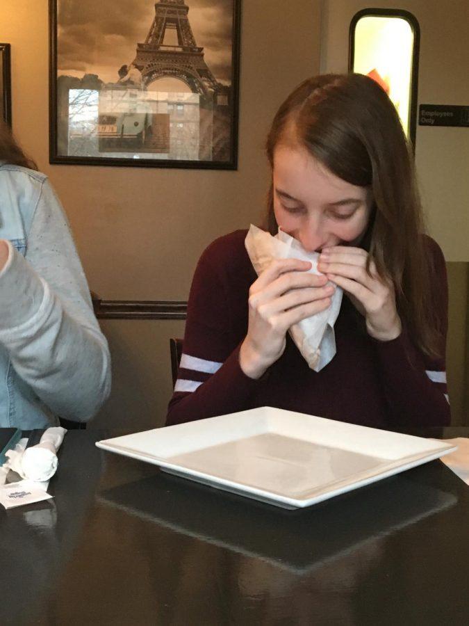 Freshman Kaitlyn Ness enjoys biting into her food.