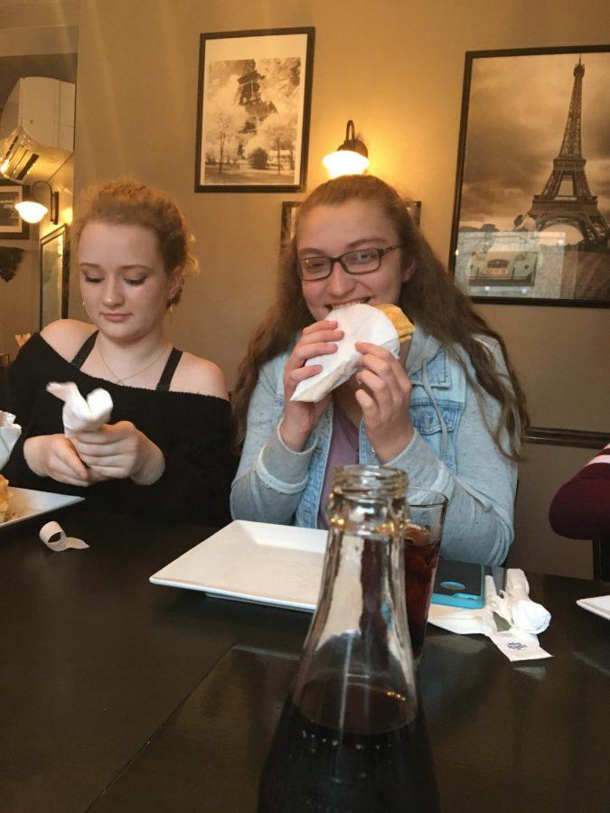 Freshmen French club members enjoy eating  crêpes at 'Rachel's Crepes' during a field trip.