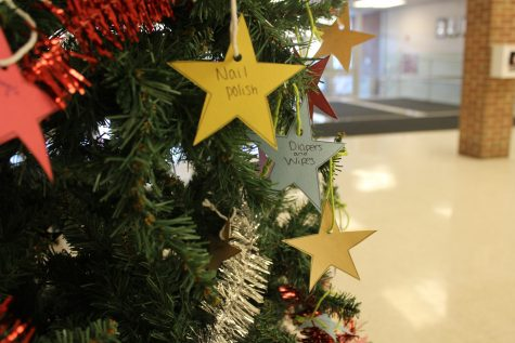 The giving tree stands in the auditorium lobby with