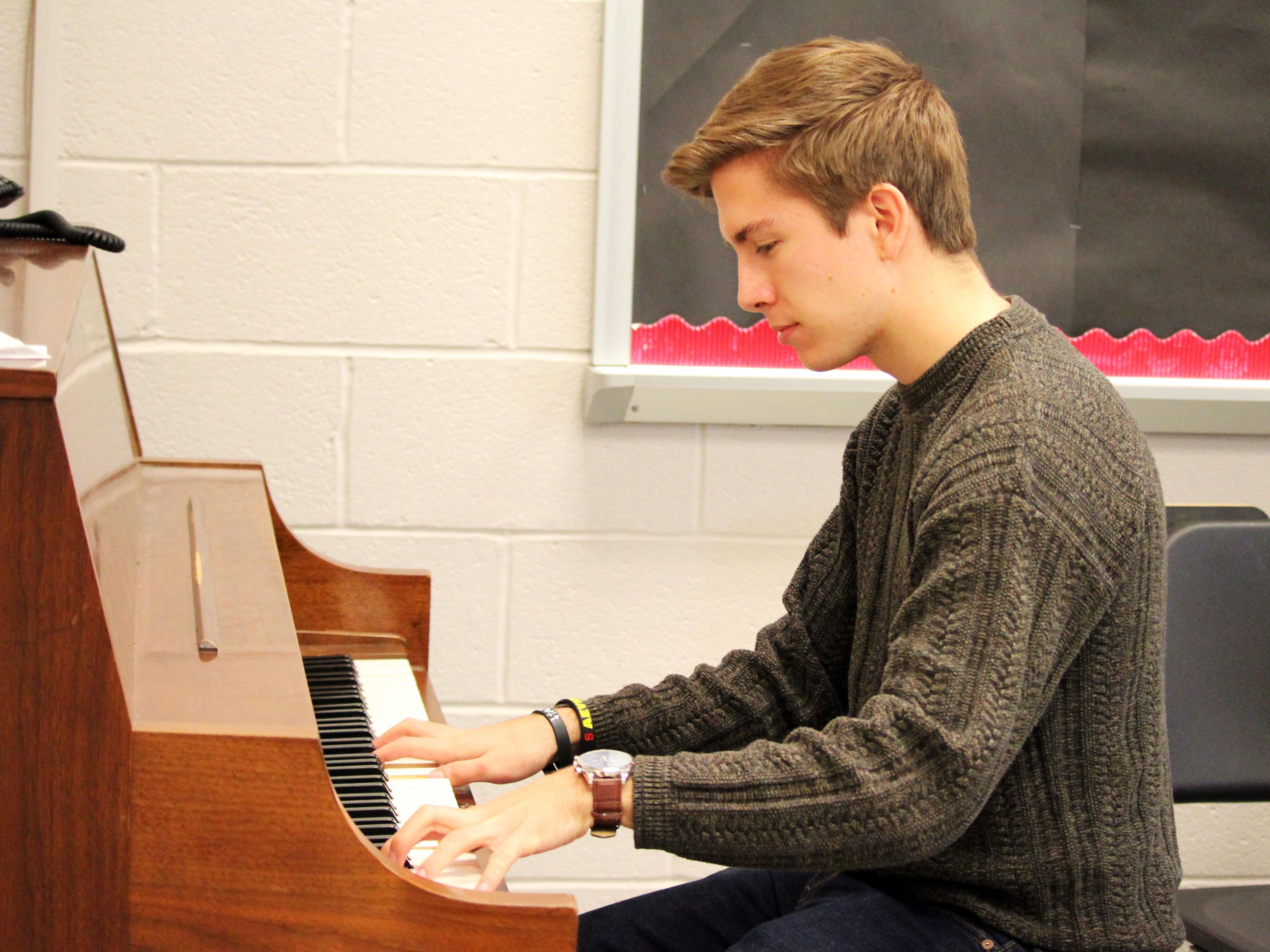 Susquehannock High School student Lucas Sherman playing the piano.