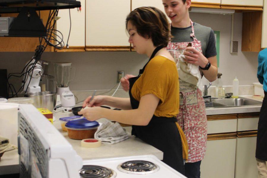 Julianna Kessler prepares food.