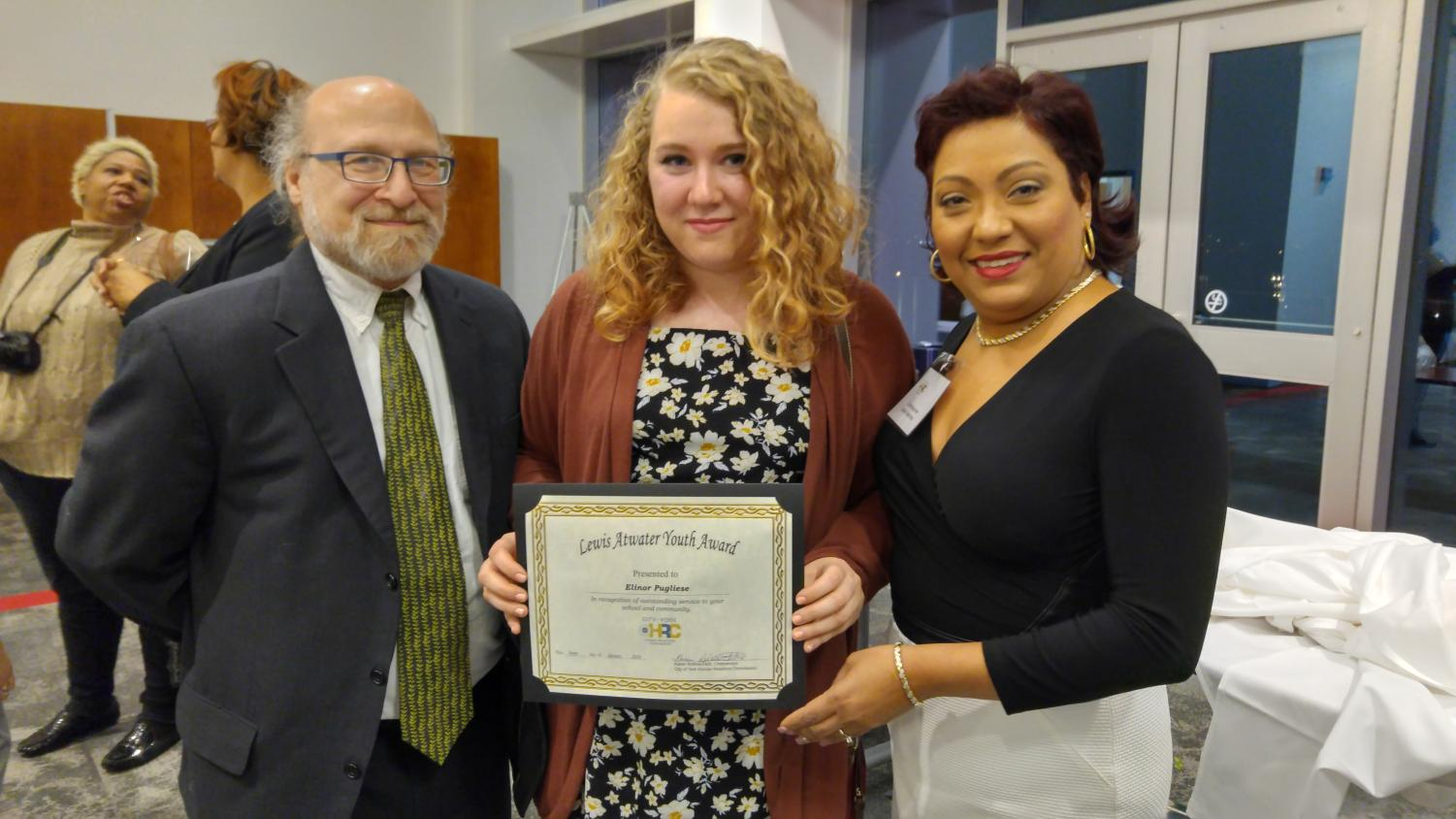 Senior Nell Pugliese receives the Lewis Atwater Youth Award pictured here with her father, Anthony Pugliese, and presenter Debra Martinez.