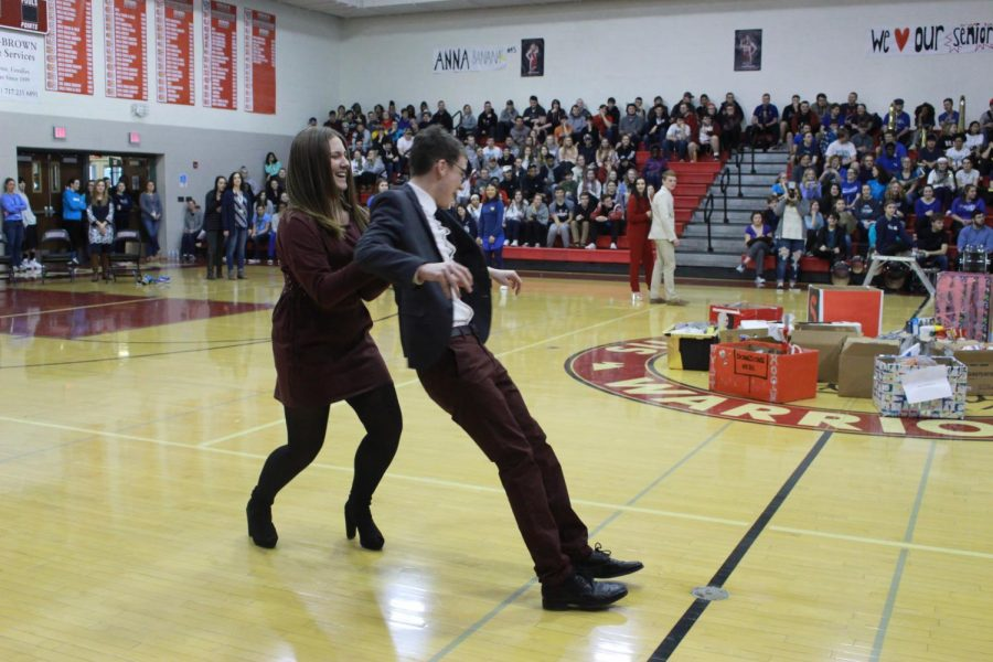 Snow King candidate Michael Torbert and his escort senior Amber Bortner participate in the decades dance during the pep rally.