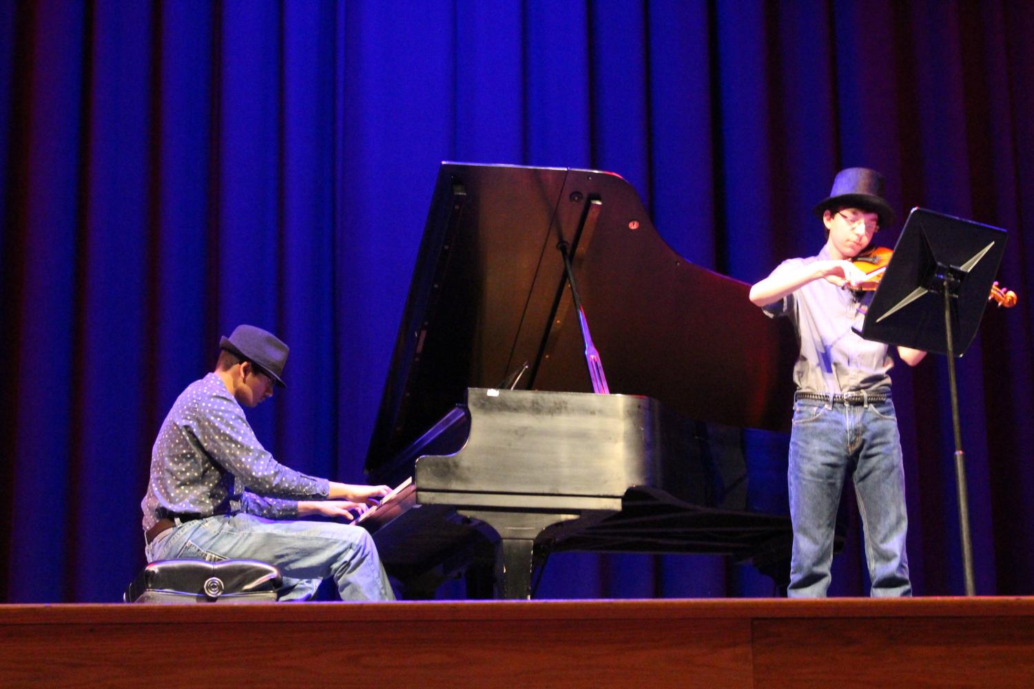 Sophomores Rohit Kandala and Coleman Bongardt perform the opening act of the talent show. [Photo by Maggie Sisler]