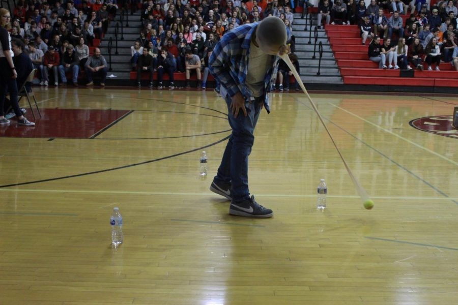 Junior Anthony Mairano participates in a game during the pep rally. Pantyhose was placed on top of the players head with a tennis ball inside. The object of the game was to knock down three water bottles with the pantyhose contraption without using ones hands.