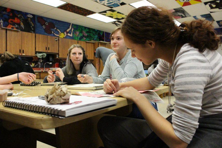 Senior Lucy Curran, junior Camryn Brakmann, and senior Mariane Harden create art while sporting gray for brain cancer.