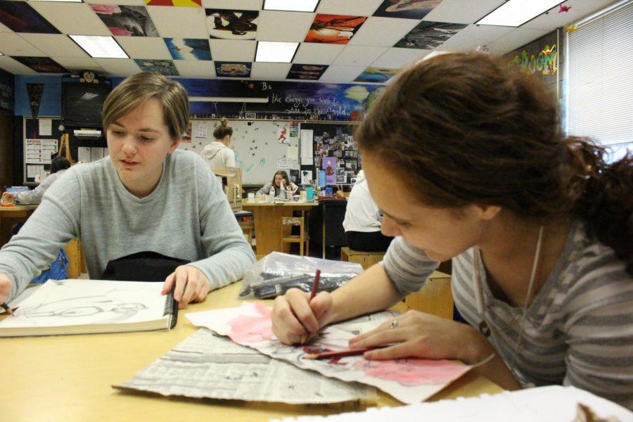 Junior Camryn Brakmann and senior Mariane Harden draw pictures and wear gray.