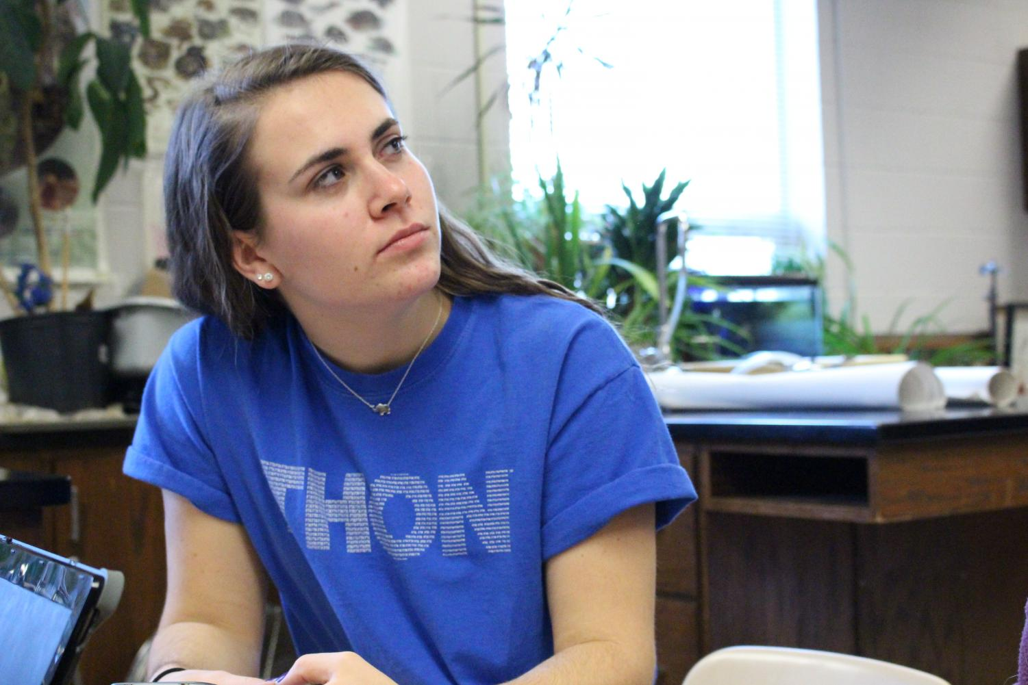 Junior Allyson Koller wears a blue THON shirt in support of the cause.