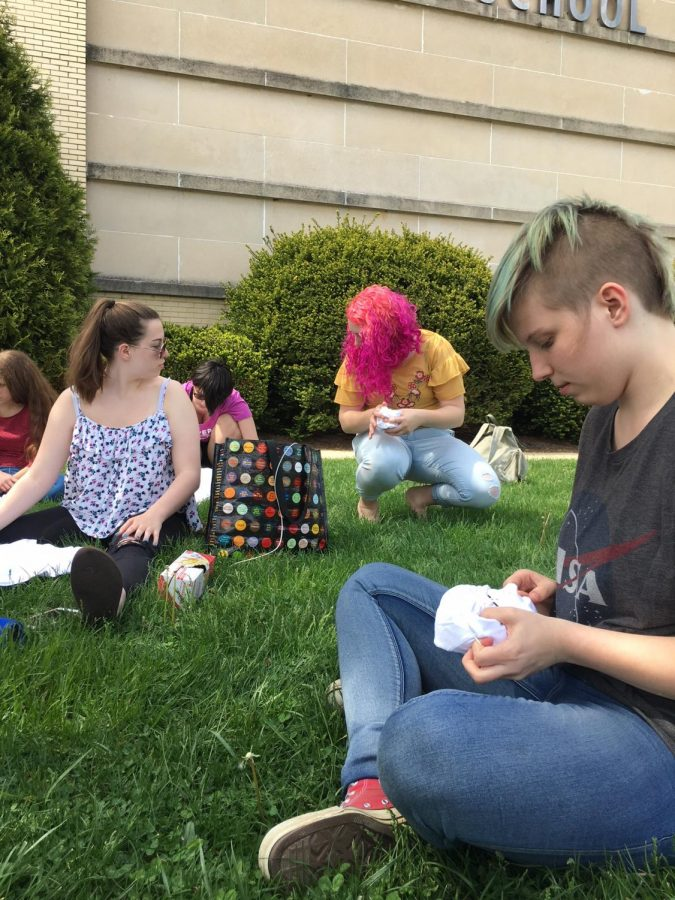After the party, members filed outside to work on tie-dying t-shirts, one last craft together.
